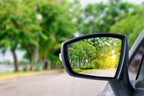 looking back in the car mirror